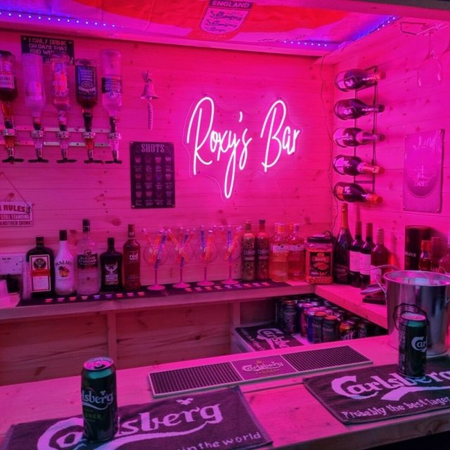Neon Sign for a garden shed bar #neonsigns #gardenshed #gardenbar #gardenbarideas #gardenshedbar #bardesign